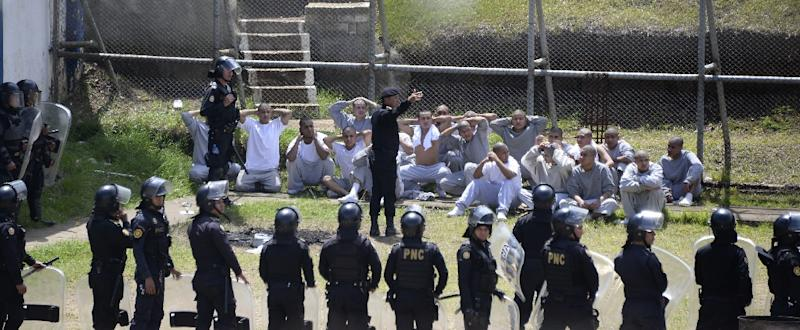 Riot police control inmates at a juvenile detention center in San Jose Pinula, east of Guatemala City, following a deadly prison riot (AFP Photo/JOHAN ORDONEZ)