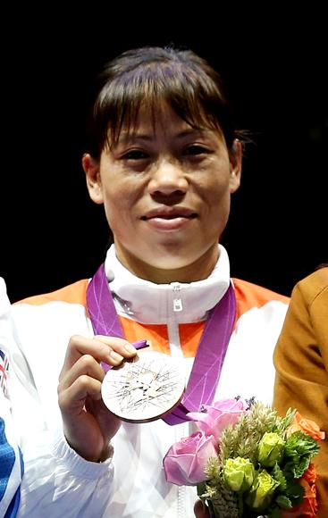 Five-times world boxing champion Mary Kom led the front page of the Times of India for securing 