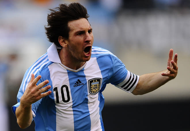 Argentinian soccer player Lionel Messi celebrates after scoring his third goal during a friendly match against Brazil at the MetLife Stadium in East Rutherford, New Jersey, on June 9, 2012. Argentina won 4-3.    AFP PHOTO/Mehdi TaamallahMEHDI TAAMALLAH/AFP/GettyImages