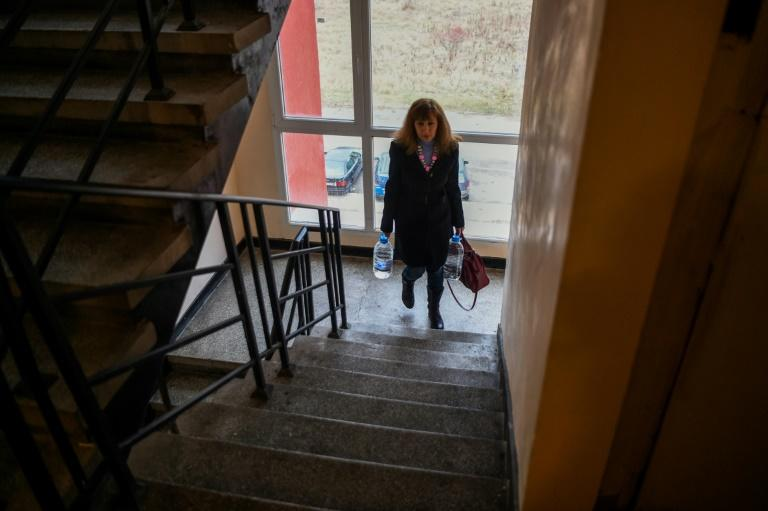 Adelina Ivanova has to haul bottles of mineral water up seven flights of stairs