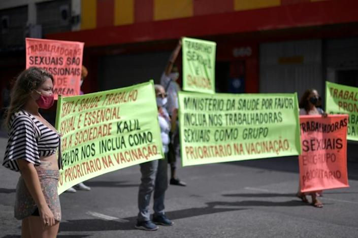 Sex workers protest at Rua Guaicurus, in Belo Horizonte, in Brazil's Minas Gerais state on April 5, 2021, asking to be considered a priority group to receive the vaccine against Covid-19