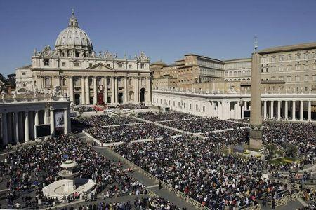 A view shows faithful gathering in St. Peter's Square as Pope Francis leads the Palm Sunday mass at the Vatican