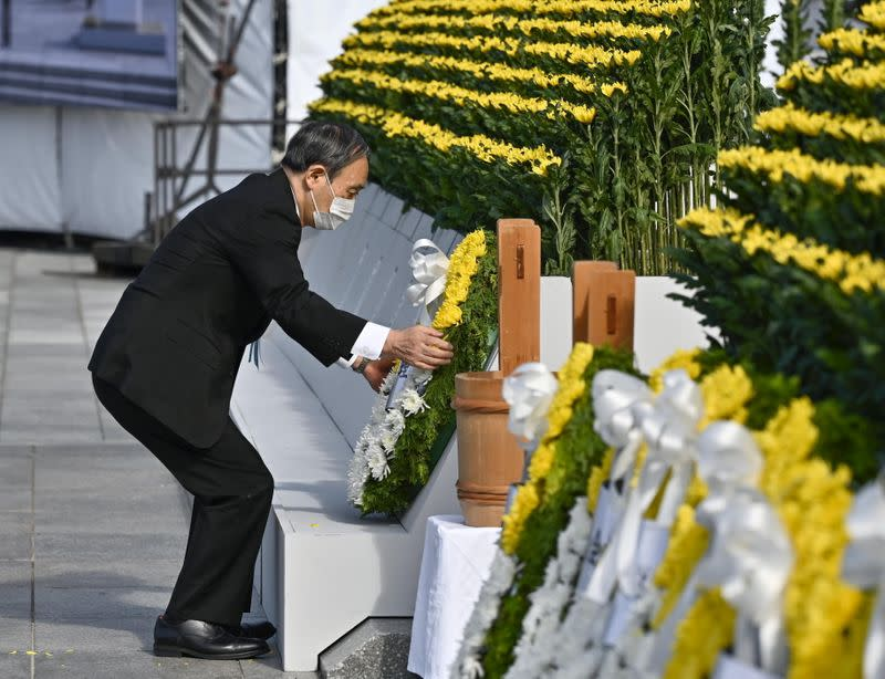 Japan's Prime Minister Yoshihide Suga places a wreath on the cenotaph for the victims of the 1945 atomic bombing in Hiroshima