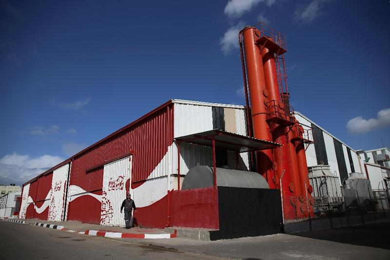 The new Coca-Cola bottling facility in the industrial area east of Gaza City, seen December 1, 2016, will provide 120 new jobs immediately, with eventual expansion to 270, according to Coca-Cola (AFP Photo/MOHAMMED ABED)