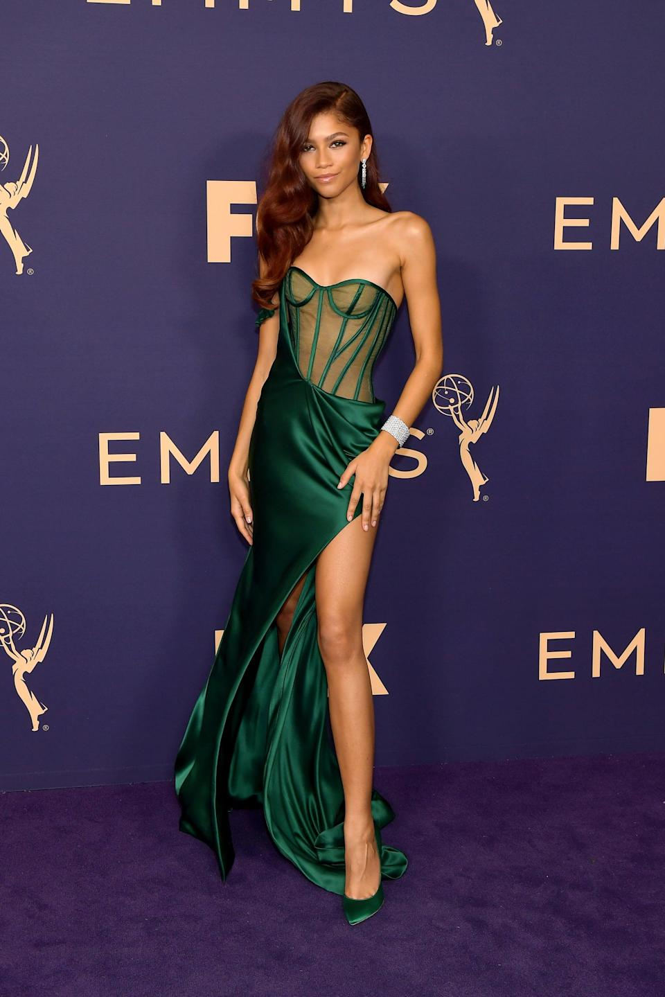 """<p><a class=""""link rapid-noclick-resp"""" href=""""https://www.popsugar.co.uk/Zendaya"""" rel=""""nofollow noopener"""" target=""""_blank"""" data-ylk=""""slk:Zendaya"""">Zendaya</a> has sought style inspiration from superheroes <em>and</em> villains. To attend the 2019 Emmy Awards, she <a href=""""https://www.popsugar.com/fashion/zendaya-vera-wang-dress-at-the-2019-emmys-46659112"""" class=""""link rapid-noclick-resp"""" rel=""""nofollow noopener"""" target=""""_blank"""" data-ylk=""""slk:wore an emerald Vera Wang corset dress"""">wore an emerald Vera Wang corset dress</a> with visible boning. Though this red carpet look understandably conjured up comparisons to <strong>The Little Mermaid</strong>'s Ariel, Law was actually inspired by <a class=""""link rapid-noclick-resp"""" href=""""https://www.popsugar.co.uk/Uma-Thurman"""" rel=""""nofollow noopener"""" target=""""_blank"""" data-ylk=""""slk:Uma Thurman"""">Uma Thurman</a>'s portrayal of Poison Ivy in <strong>Batman &amp; Robin</strong>, and he shared several stills from the 1997 film to Instagram Stories the day of the award show.</p>"""