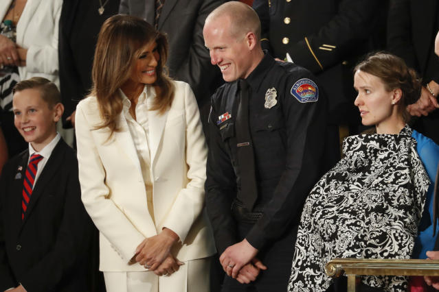 <p>First lady Melania Trump talks with Albuquerque police officer Ryan Holets and his wife before the State of the Union address to a joint session of Congress on Capitol Hill in Washington, D.C., on Jan. 30. (Photo: Pablo Martinez Monsivais/AP) </p>