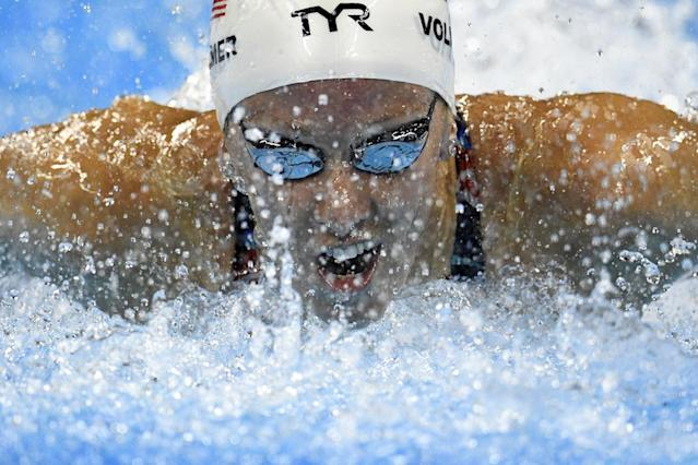 USA's Dana Vollmer takes part in the Women's 100m Butterfly heat during the swimming event at the Rio 2016 Olympic Games at the Olympic Aquatics Stadium in Rio de Janeiro on August 6, 2016. (AFP Photo/Martin BUREAU)