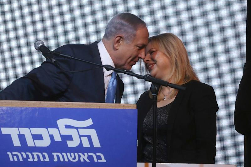 Benjamin Netanyahu kisses his wife Sara after exit poll figures in Israel's parliamentary elections late on March 17, 2015 in Tel Aviv