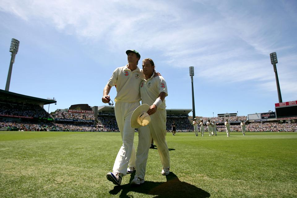 Retiring Australian bowler Glenn McGrath, left, and Shane Warne walk off the field hugging each other.