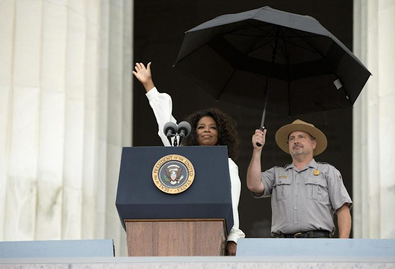 "Oprah Winfrey waves as she arrives to speak during a ceremony commemorating the 50th anniversary of the March on Washington, Wednesday, Aug. 28, 2013, at the Lincoln Memorial in Washington. President Barack Obama was set to lead civil rights pioneers Wednesday in a ceremony for the 50th anniversary of the March on Washington, where Dr. Martin Luther King's ""I Have a Dream"" speech roused the 250,000 people who rallied there decades ago for racial equality. (AP Photo/Evan Vucci)"