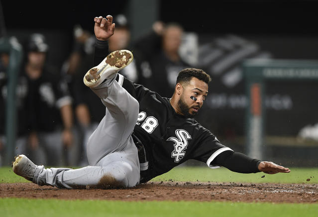 Chicago White Sox's Leury Garcia slides across home plate to score against the Baltimore Orioles on a single by Jose Abreu in the fourth inning of a baseball game, Monday, April 22, 2019, in Baltimore. (AP Photo/Gail Burton)