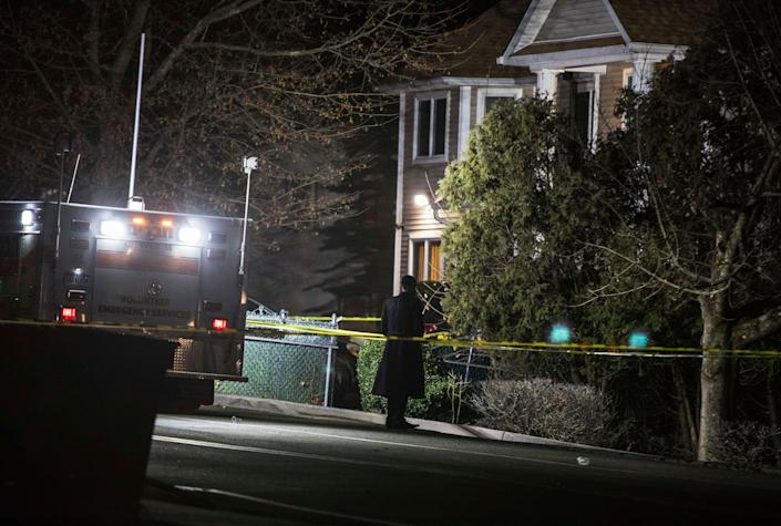 An Orthodox Jewish man stands in front of a residence in Monsey, New York, following a stabbing late Saturday during a Hanukkah celebration. (Photo: ASSOCIATED PRESS)