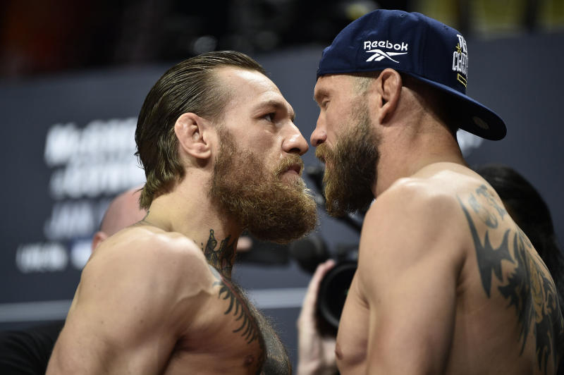 LAS VEGAS, NEVADA - JANUARY 17: (L-R) Conor McGregor of Ireland and Donald Cerrone face off during the UFC 246 weigh-in at Park Theater at Park MGM on January 17, 2020 in Las Vegas, Nevada. (Photo by Chris Unger/Zuffa LLC)