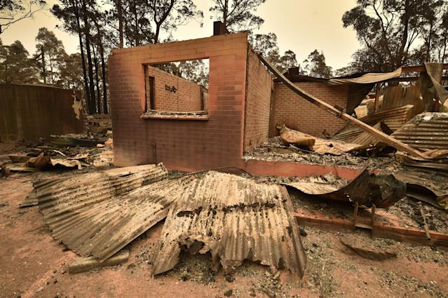 The remains of a house destroyed by a bushfire is seen just outside Batemans Bay in New South Wales on Jan. 2, 2020. Australia authorized the forced evacuation of residents amid a mass exodus of tourists from fire-ravaged coastal communities, as the country braces for a weekend heatwave expected to fan deadly bushfires. (Photo by PETER PARKS/AFP via Getty Images)