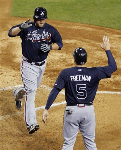 Hanson, Uggla lead Braves to 3-2 win over D-backs