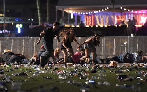 <span>Route 91 Harvest country music festival flee the scene</span> <span>Credit: David Becker/Getty </span>