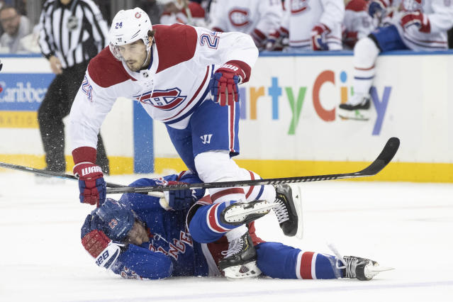 Montreal Canadiens center Phillip Danault (24) trips over New York Rangers defenseman Adam Fox (23) during the second period of an NHL hockey game Friday, Dec. 6, 2019, at Madison Square Garden in New York. (AP Photo/Mary Altaffer)