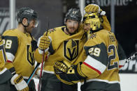 Vegas Golden Knights defenseman Shea Theodore (27) embraces goaltender Marc-Andre Fleury (29) after defeating the Arizona Coyotes in an NHL hockey game Wednesday, Jan. 20, 2021, in Las Vegas. (AP Photo/John Locher)