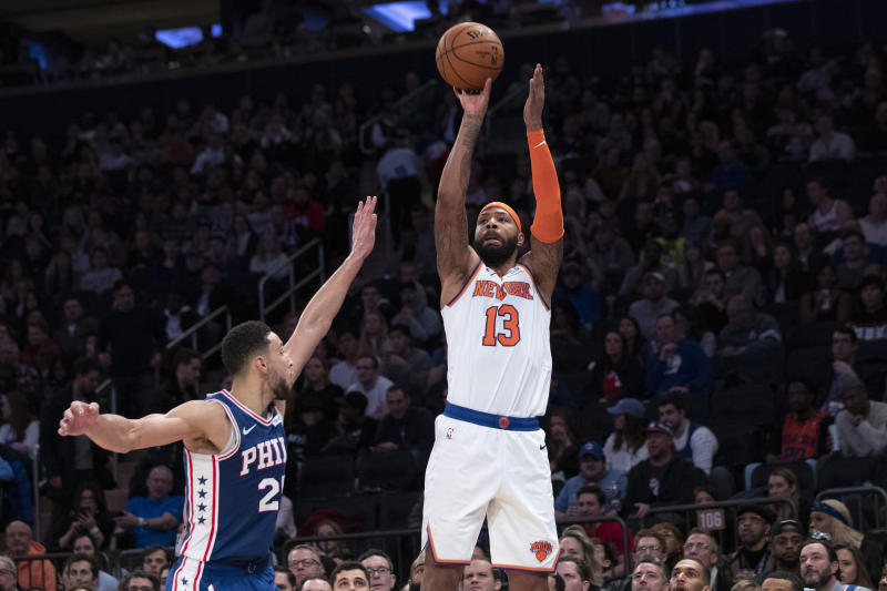 New York Knicks forward Marcus Morris Sr. (13) shoots a three-point basket past Philadelphia 76ers guard Ben Simmons (25) in the second half of an NBA basketball game, Saturday, Jan. 18, 2020, at Madison Square Garden in New York. (AP Photo/Mary Altaffer)