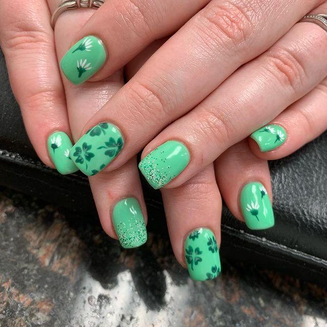 """<p>Whether you're adding glitter to the tips or mini shamrocks, these nails prove that you can add pretty much anything you want to a light green base and it will come out as festive as can be.</p><p><a class=""""link rapid-noclick-resp"""" href=""""https://www.amazon.com/Sally-Hansen-Insta-Dri-Jelly-Polish/dp/B07JNDJ9DH/?tag=syn-yahoo-20&ascsubtag=%5Bartid%7C10055.g.26310821%5Bsrc%7Cyahoo-us"""" rel=""""nofollow noopener"""" target=""""_blank"""" data-ylk=""""slk:SHOP GREEN NAIL POLISH"""">SHOP GREEN NAIL POLISH</a></p><p><a href=""""https://www.instagram.com/p/BvIFe1LBlsq/&hidecaption=true"""" rel=""""nofollow noopener"""" target=""""_blank"""" data-ylk=""""slk:See the original post on Instagram"""" class=""""link rapid-noclick-resp"""">See the original post on Instagram</a></p>"""
