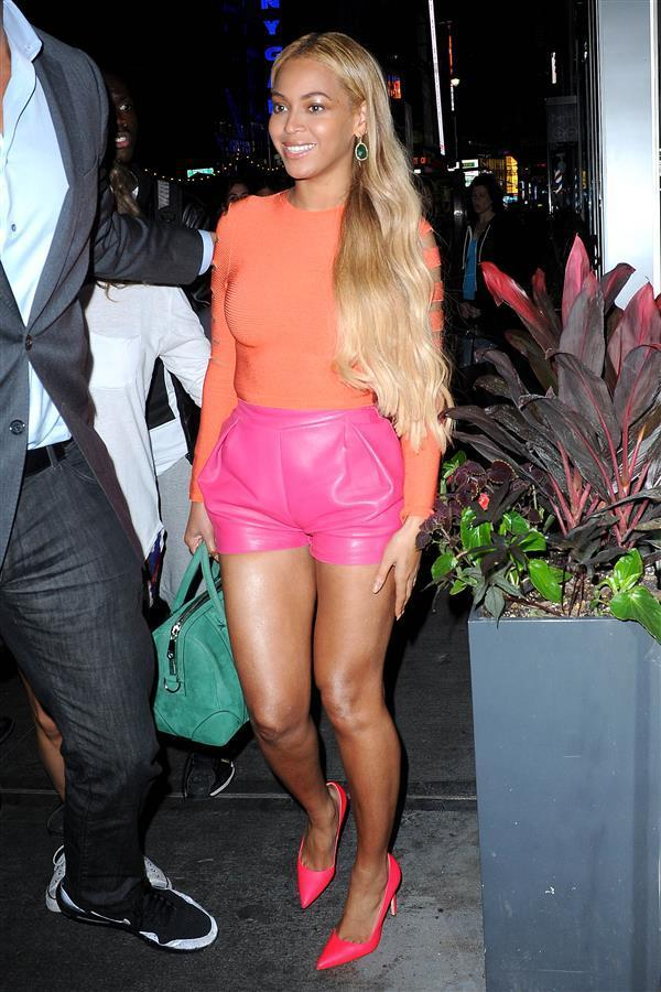"""Beyoncé always take risks when it comes to her fashion. Whether it's on the red carpet wearing a sheer Givenchy gown at the Met Ball or TopShop crop top sets on the streets, the """"Crazy in Love"""" singer's always setting trends, not following them. But when she stepped out in New York City on Thursday, she tried something out that only seasoned fashion girls before her had ever dared to wear. She pulled it off well, with her own Queen Bey twist, in an orange long-sleeved Cushnie et Ochs shirt with slits on the sleeves, pink DSquared2 leather shorts, magenta heels, emerald drop earrings, and a turquoise bag."""