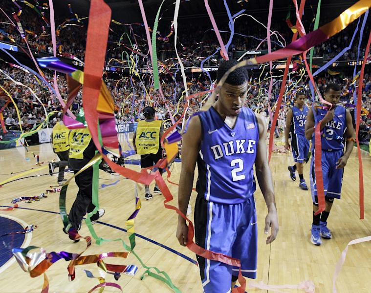 Duke's Quinn Cook (2) walks off the court after losing to Virginia in an NCAA college basketball game in the championship for the Atlantic Coast Conference tournament in Greensboro, N.C., Sunday, March 16, 2014. Virginia won 72-63. (AP Photo/Gerry Broome)