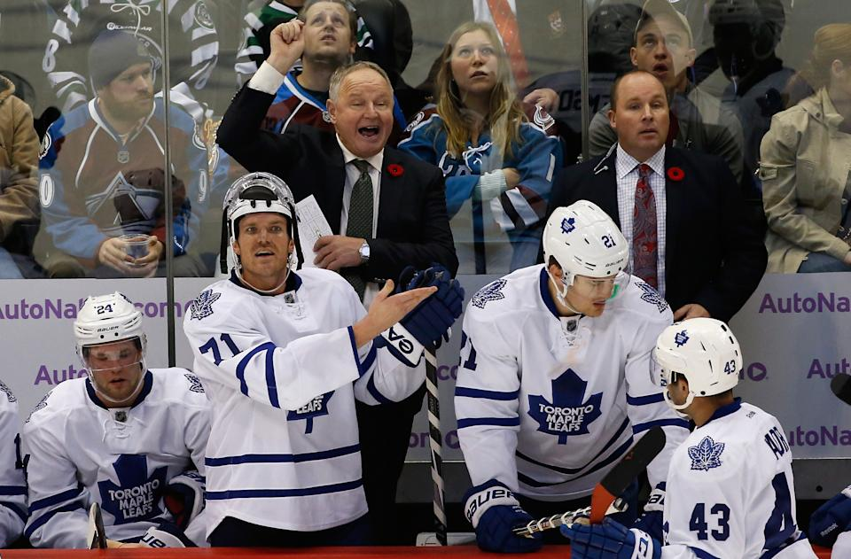 DENVER, CO - NOVEMBER 06: Head coach Randy Carlyle of the Toronto Maple Leafs leads his team against the Colorado Avalanche at Pepsi Center on November 6, 2014 in Denver, Colorado. The Avalanche defeated the Maple Leafs 4-3 in an overtime shootout. (Photo by Doug Pensinger/Getty Images)