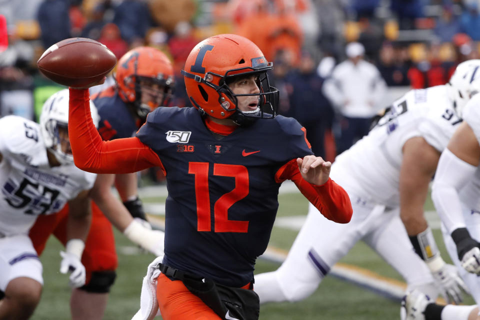 Illinois quarterback Matt Robinson (12) passes on the run during the first half of an NCAA college football game against Northwestern, Saturday, Nov. 30, 2019, in Champaign, Ill. (AP Photo/Charles Rex Arbogast)