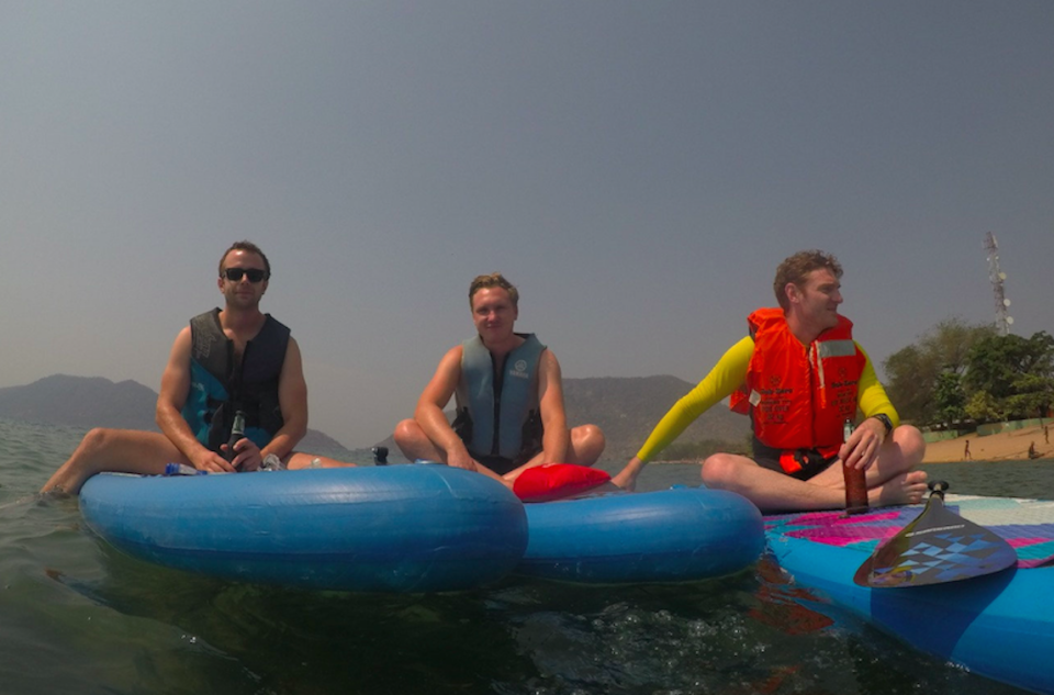James Michael, centre, with friends at Lake Malawi in 2017 (Picture: SWNS)