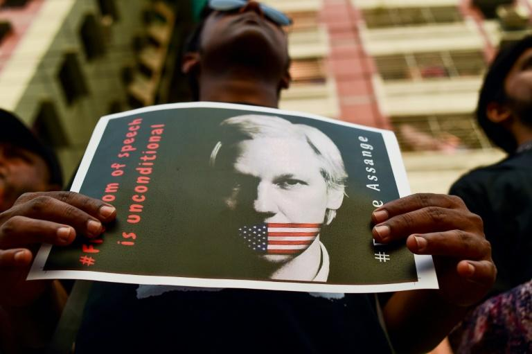 """For many, """"freedom of speech is unconditional,"""" as the placard says, and that includes for WikiLeaks founder Julian Assange"""