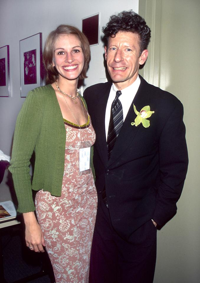"""Julia's low profile went out the window in 1993 when, at age 25, she secretly married country singer Lyle Lovett after dating for just three weeks. The two first met after appearing in """"The Player,"""" although they did not share any scenes together. At the time, Lovett was in a relationship – in fact, he and his girlfriend were hoping to meet the actress during filming! – but soon enough, he and Julia were head over heels. Then on June 25, during a weekend break from shooting """"The Pelican Brief,"""" the odd couple threw together a last-minute wedding in just 72 hours in Marion, Indiana. Fellow celeb Susan Sarandon served as a bridesmaid and Sarandon's daughter Eva Amurri was a flower girl. The affair was jaw-dropping to both fans <em>and</em> his conservative Southern family. Julia's $2,000 slip dress was so thin, """"You could see her belly button!"""" one of Lovett's relatives complained to <em>People</em> magazine. Worse yet, the bride was also barefoot! Just 21 months later, Julia and Lovett called it quits."""