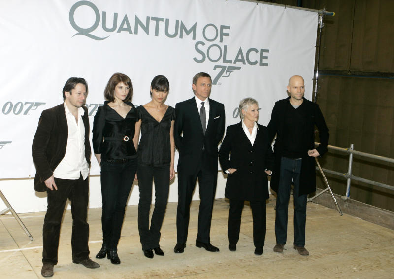 """FILE - This Jan. 24, 2008 file photo shows actors, from left, Mathieu Amalric, Gemma Arterton, Olga Kurylenko, Daniel Craig, Judy Dench, and director Marc Forster posing at a photo call for the Bond film, """"Quantum of Solace,"""" at Pinewood Studios in Buckinghamshire, England. Georgia's film industry is booming and big plans are in the works for major studio projects. Of those studio projects in the works, one being planned in Fayette County, a short drive south of Atlanta, could be a game changer. British film studio Pinewood Shepperton PLC, home to the James Bond franchise, has reportedly been in talks with a group of investors to manage and operate the facility. It would be Pinewood's first production facility in the U.S. (AP Photo/Kirsty Wigglesworth, File)"""