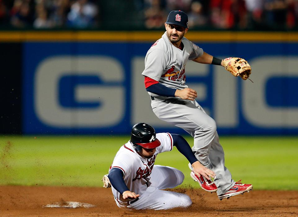Daniel Descalso #33 of the St. Louis Cardinals attempts to turn a double play as Freddie Freeman #5 of the Atlanta Braves slides into second base as Dan Uggla #26 is safe at first in the eighth inning during the National League Wild Card playoff game at Turner Field on October 5, 2012 in Atlanta, Georgia. (Photo by Kevin C. Cox/Getty Images)
