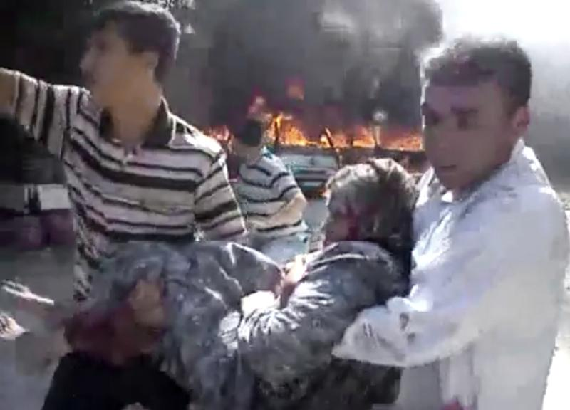 In this image made from amateur video released by the Shaam News Network and accessed Tuesday, Aug. 28, 2012, Syrian men carry a wounded elderly woman from purported airstrikes in Kfarnebel, Idlib province, northern Syria. (AP Photo/Shaam News Network via AP video) THE ASSOCIATED PRESS IS UNABLE TO INDEPENDENTLY VERIFY THE AUTHENTICITY, CONTENT, LOCATION OR DATE OF THIS HANDOUT PHOTO