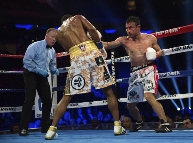 Juan Pablo Sanchez tries to hit Jamel Herring during their lightweight boxing bout Saturday, May 12, 2018, in New York. (AP Photo/Kevin Hagen)