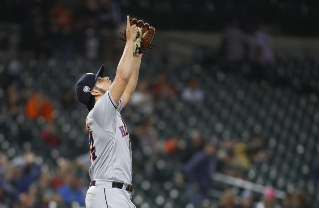 Houston Astros relief pitcher Roberto Osuna celebrates the final out in the ninth inning of a baseball game against the Detroit Tigers in Detroit, Tuesday, Sept. 11, 2018. Houston won 5-4. (AP Photo/Paul Sancya)