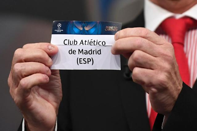 Welsh former player Ian Rush shows the name of Atletico Madrid football club during the UEFA Champion's league draw semi-finals, on April 21, 2017 in Nyon (AFP Photo/Richard Juilliart)