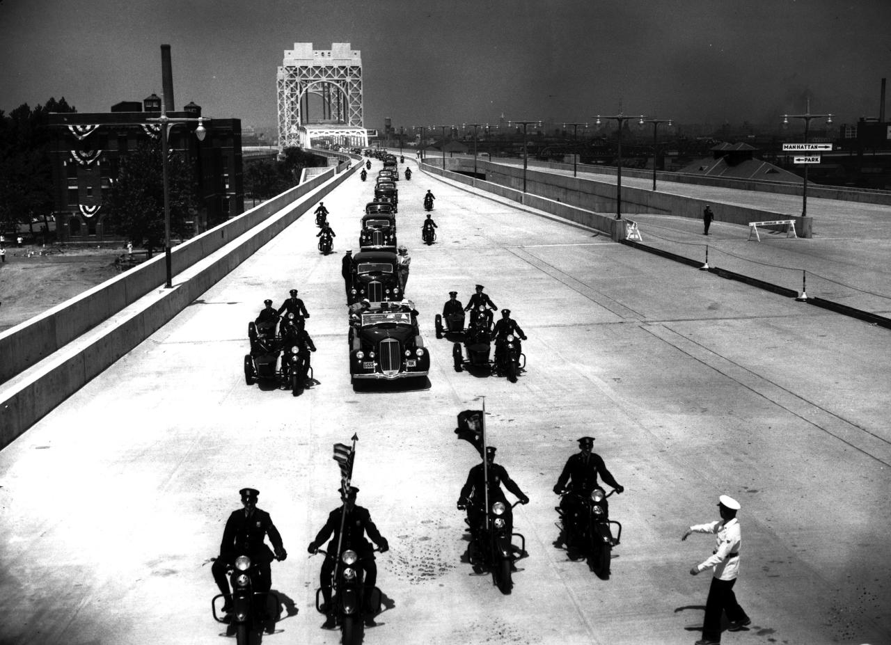 The Triborough Bridge, which links Bronx, Manhattan and Queens, formally opens as U.S. President Franklin D. Roosevelt, dignitaries and State Troopers cross the bridge for the first time in New York City on July 11, 1936.  (AP Photo)