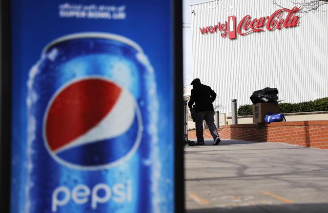 <p> A Pepsi advertisement stands outside the World of Coca-Cola museum as a vendor stocks his kiosk in Atlanta, Wednesday, Jan. 30, 2019. The Patriots and the Rams aren't the only ones battling for Super Bowl supremacy this week. Pepsi and Coke also seem to be squaring off. Pepsi, an official NFL sponsor of Super Bowl 53, has invaded Coke's home turf, its headquarters are in Atlanta. (AP Photo/David Goldman) </p>