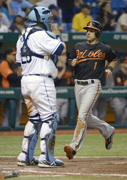 Baltimore Orioles second baseman Brian Roberts (1) scores on a double by Adam Jones as Tampa Bay Rays catcher Jose Molina (28) watches in the seventh inning of a baseball game in St. Petersburg, Fla., Friday, Sept. 20, 2013.(AP Photo/Phelan M. Ebenhack)