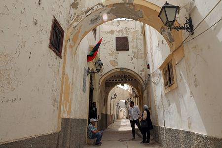 Libyans are seen in the old city of Tripoli, Libya April 23, 2019. Picture taken April 23, 2019. REUTERS/Ahmed Jadallah