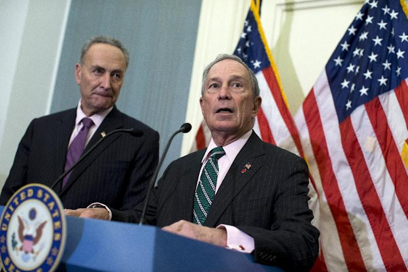 New York City Mayor Michael Bloomberg, right, accompanied by Sen. Charles Schumer, D-N.Y. speaks during a news conference on Capitol Hill in Washington, Wednesday, Nov. 28, 2012, to discuss disaster relief funds for Superstorm Sandy. (AP Photo/ Evan Vucci)