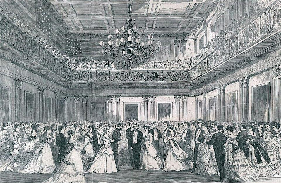 """<p>President Ulysses S. Grant and his wife, Julia Grant, are illustrated arriving at his inaugural ball in 1869. While Grant's first inauguration went off without a hitch, his second was held in a wooden ballroom built specifically for the occasion, but not suitable for the below freezing temperatures. Stories from the evening <a href=""""https://boundarystones.weta.org/2013/03/06/president-grants-wintry-inaugural-disaster"""" rel=""""nofollow noopener"""" target=""""_blank"""" data-ylk=""""slk:include guests huddled in overcoats"""" class=""""link rapid-noclick-resp"""">include guests huddled in overcoats</a> and frozen champagne served in glasses. </p>"""
