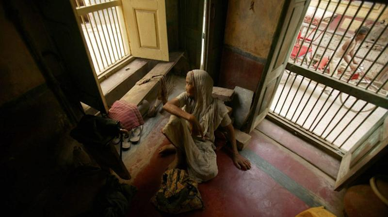 A woman rests in an old age home in the pilgrimage town of Vrindavan