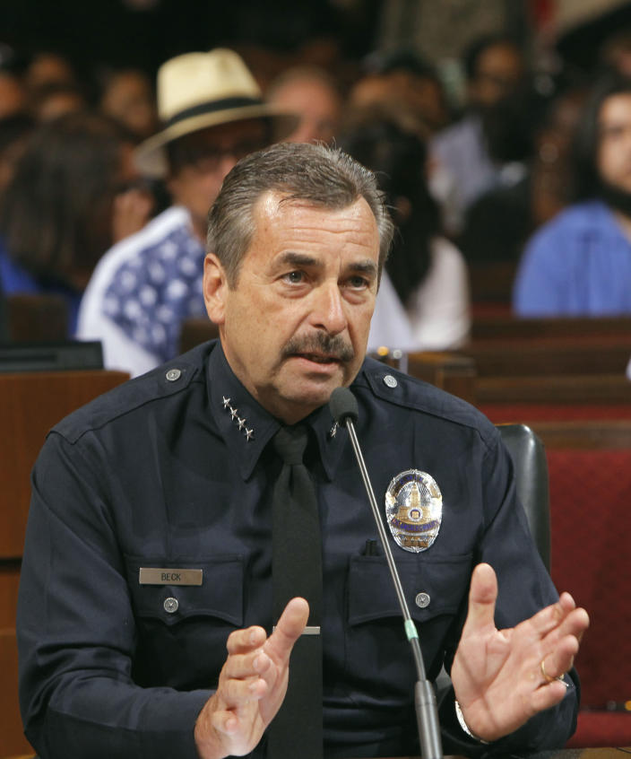 Los Angeles Police Chief Charlie Beck speaks a Los Angeles City Council meeting where the issue of whether to ban marijuana dispensaries that have sprung up throughout the city was being considered. The city has fumbled with its medical marijuana laws for years, trying to provide safe and affordable access to the drug for legitimate patients while addressing worries by neighborhood groups that streets were being overrun by dispensaries and pot users. (AP Photo/Nick Ut)
