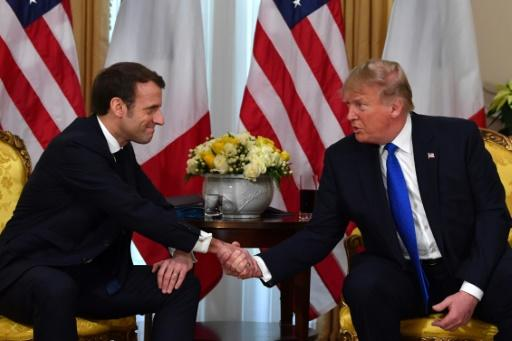 US President Donald Trump (R) met with French President Emmanuel Macron met before the NATO summit