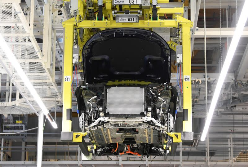 FILE PHOTO: A battery cell is installed at a Mercedes-Benz EQC electric car in a production line at a plant in Bremen