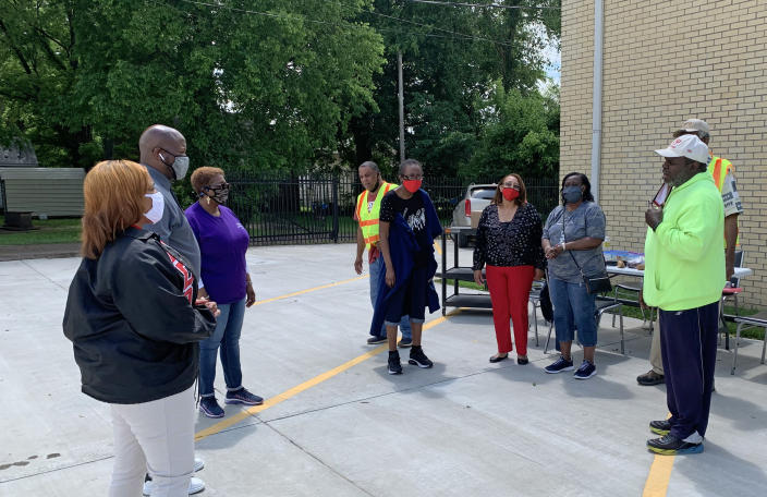 Thaddeus Williams, right, pastor of Tulane Baptist Church, talks outside of a vaccination event in the congregation's parking lot in Yazoo, Miss. (Bracey Harris / NBC News)