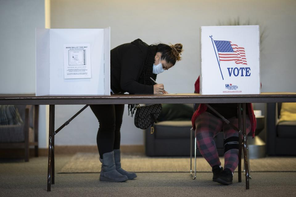 Voters mark their ballots at Journey Church polling center on Election Day on Tuesday, Nov. 3, 2020, in Kenosha, Wis. (AP Photo/Wong Maye-E)