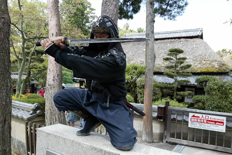 """The ninjas duties will include performing back flips, using the trademark """"shuriken"""" ninja star weapon and posing for photographs with tourists"""